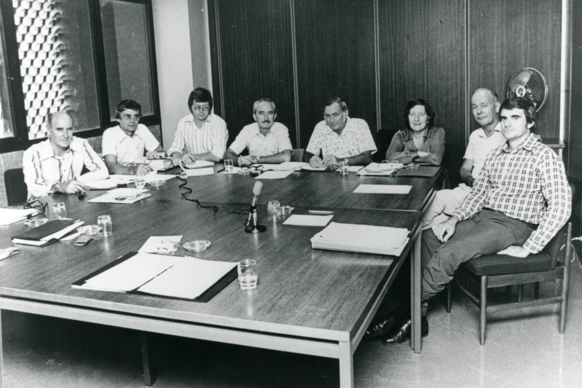 Meeting of Darwin Reconstruction Committee. L-R: Ron Thomas (Construction); Ian Morrison (Housing and Construction Department); Phil Spring; Frank Dwyer (Acting Chairman); John Parsons (General Manager); Dr Ella Stack (Darwin City Council); Vern O'Brien (Dept. of Northern Territory); Grant Tambling (Legislative Assembly).
