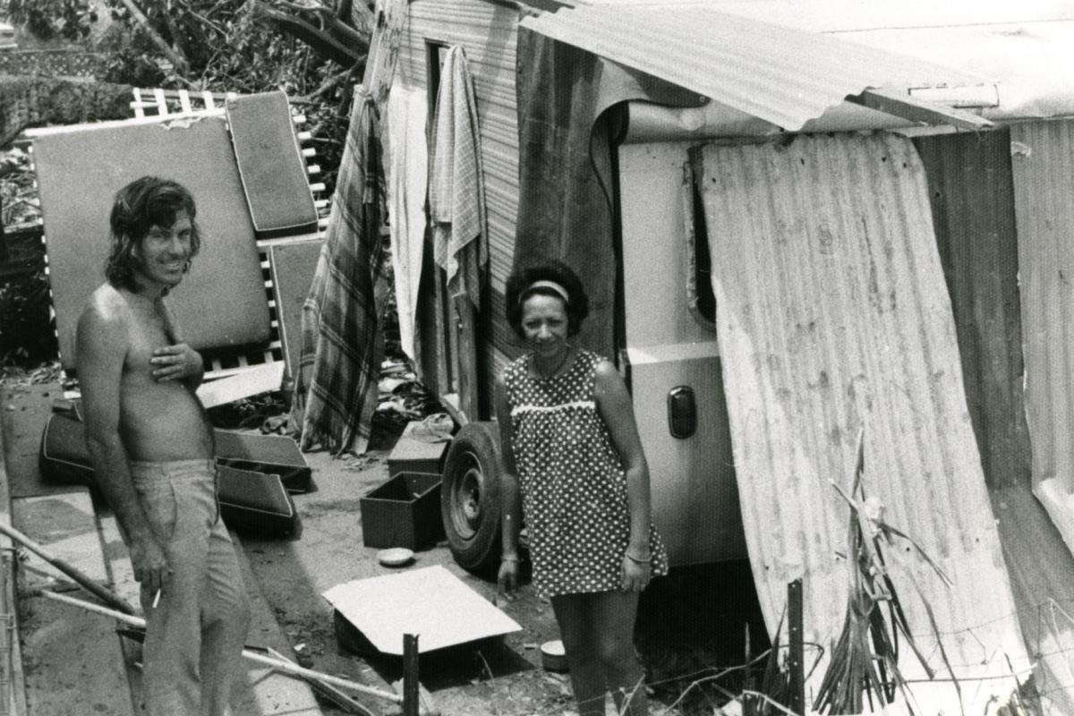 Bill and Polly Day at their van, covered in aluminium sheeting, on corner of McMinn Street