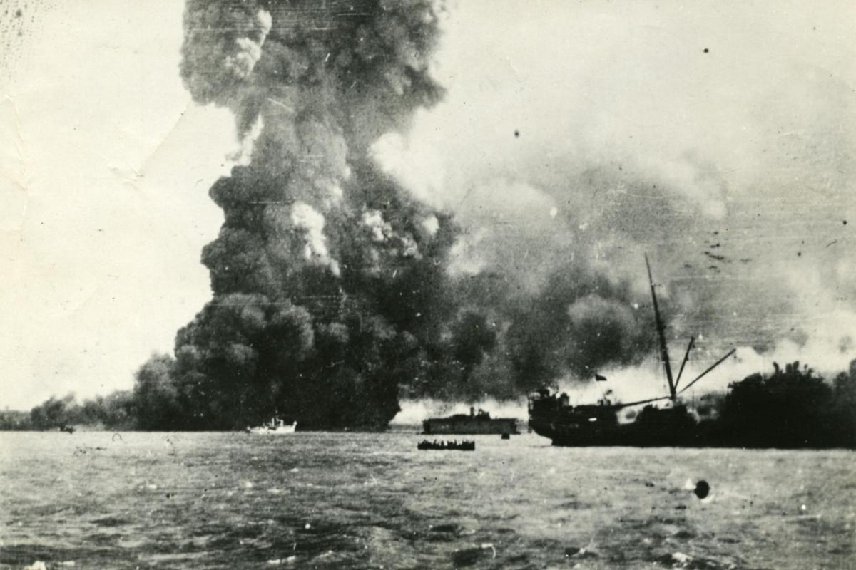 Ship at sea, the 'Neptuna' exploding at Darwin wharf.