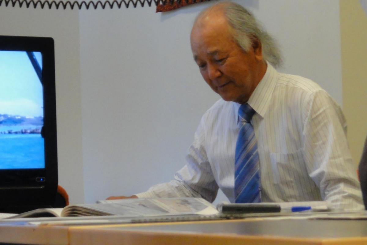 Ryugo Fujita's son Senichiro Fujita donating a collection of photographs and manuscripts from the Fujita salvage operation at Northern Territory Library.