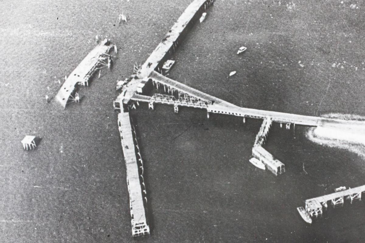 An aerial view of the MV Neptuna lying on its side near Stokes Hill Wharf in Darwin.