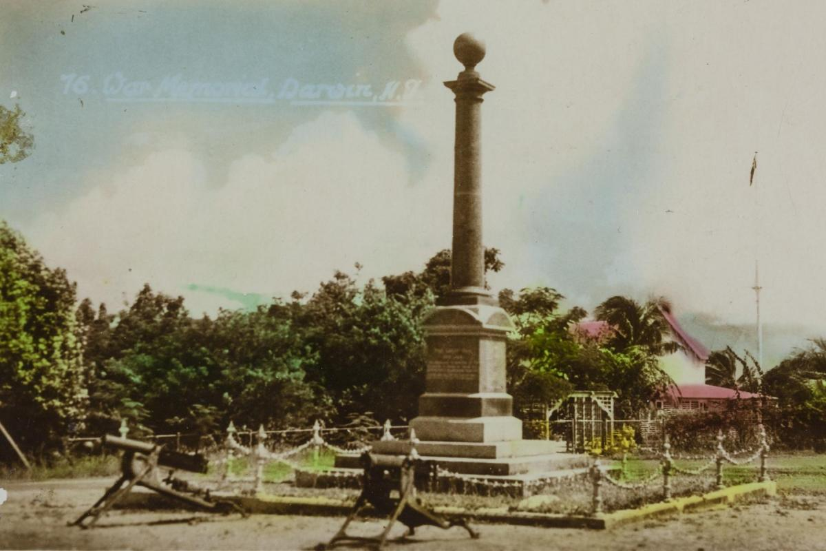 The Cenotaph is at Centre with Government House in the background and two machine guns in the foreground.