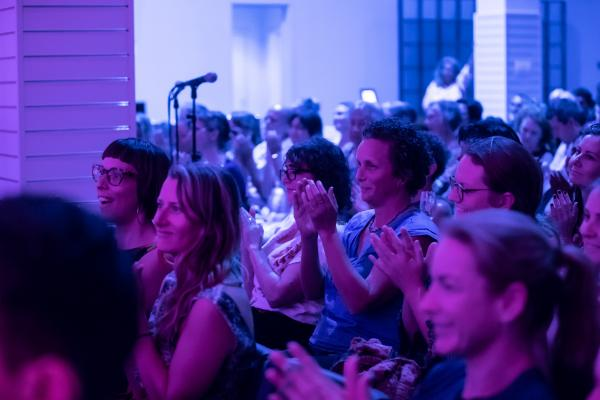 Audience members applauding at SPUN event