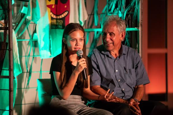 Daughter Emma King telling her story while father Charlie King looks on