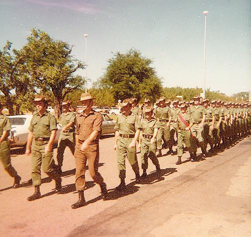 Soldiers outside marching in a line.