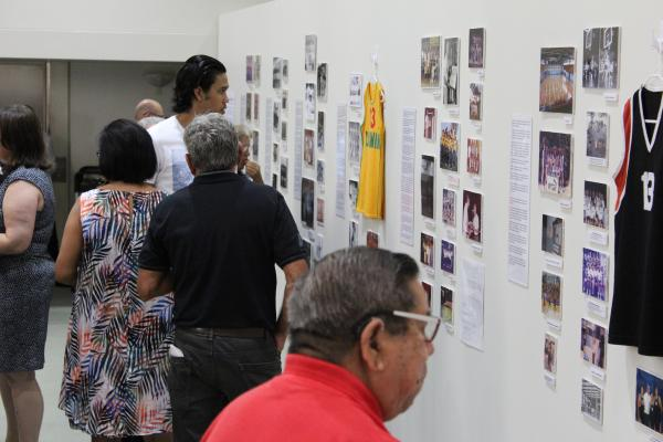 Crowd of people looking at exhibition wall