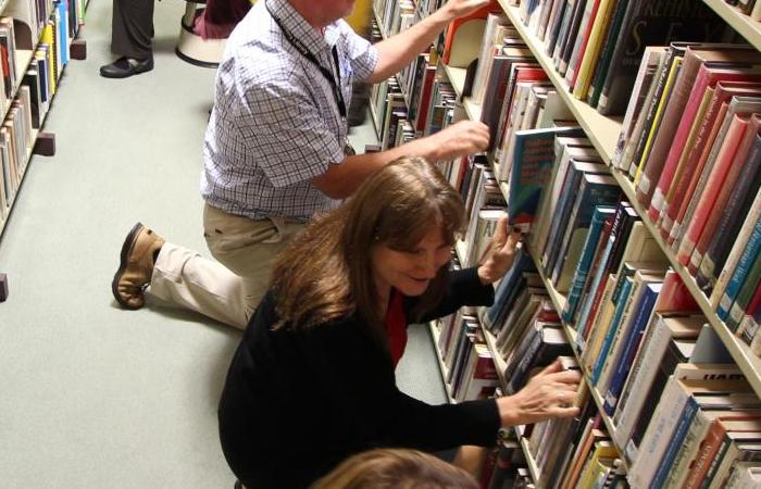 People looking for books on shelves
