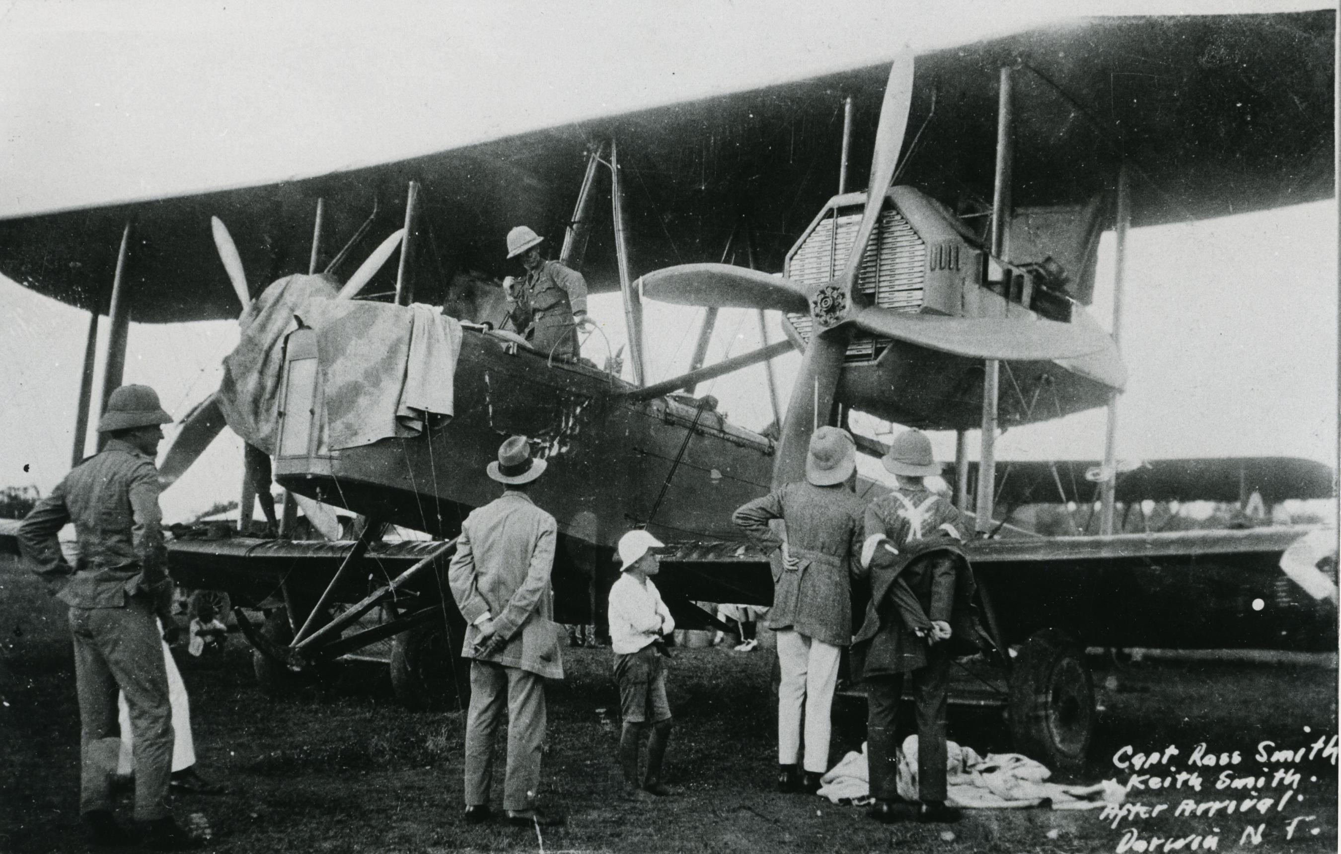 Group of people inspecting a plane on the ground