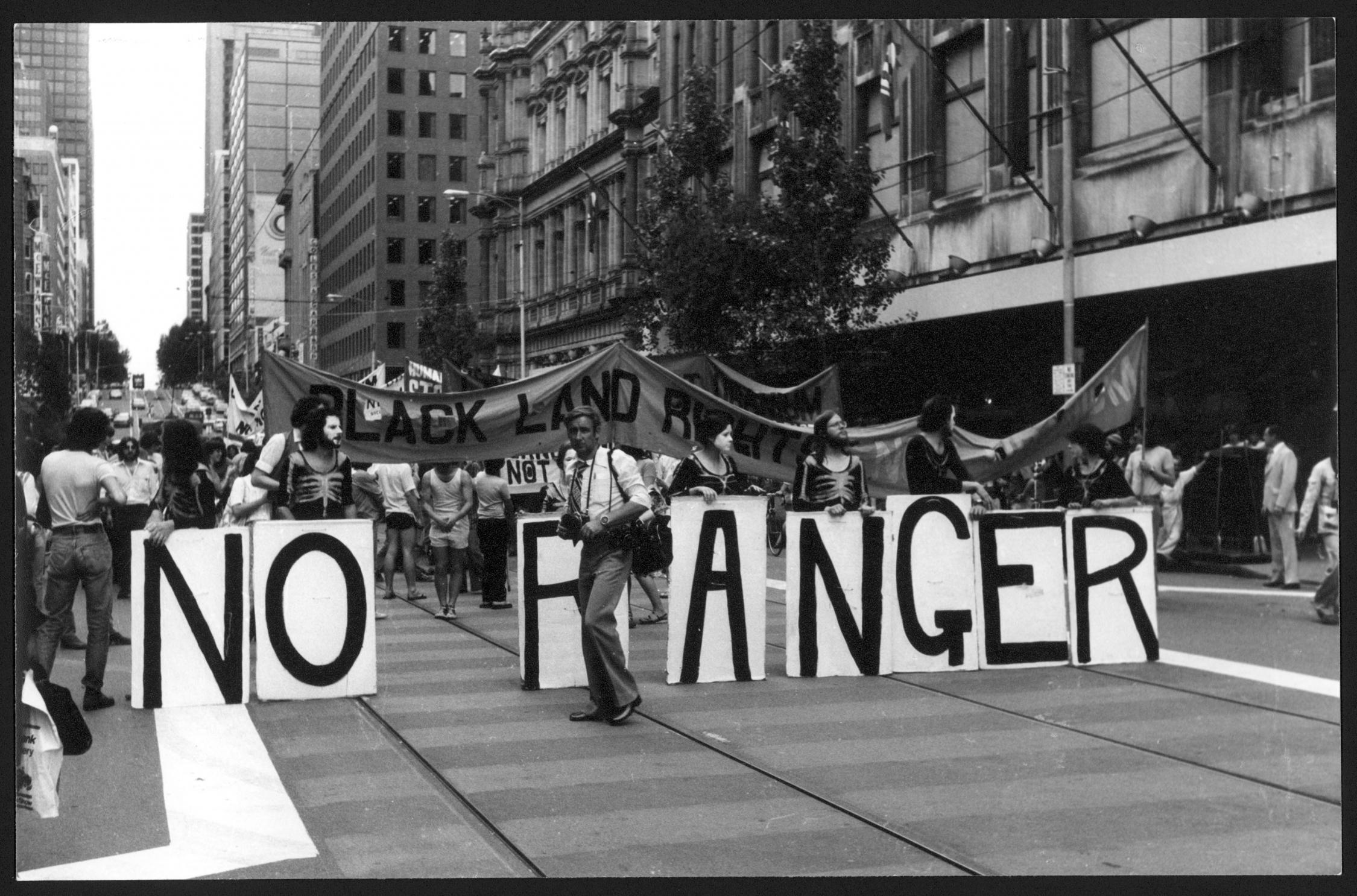 Street protest featuring a 'No Ranger' sign.