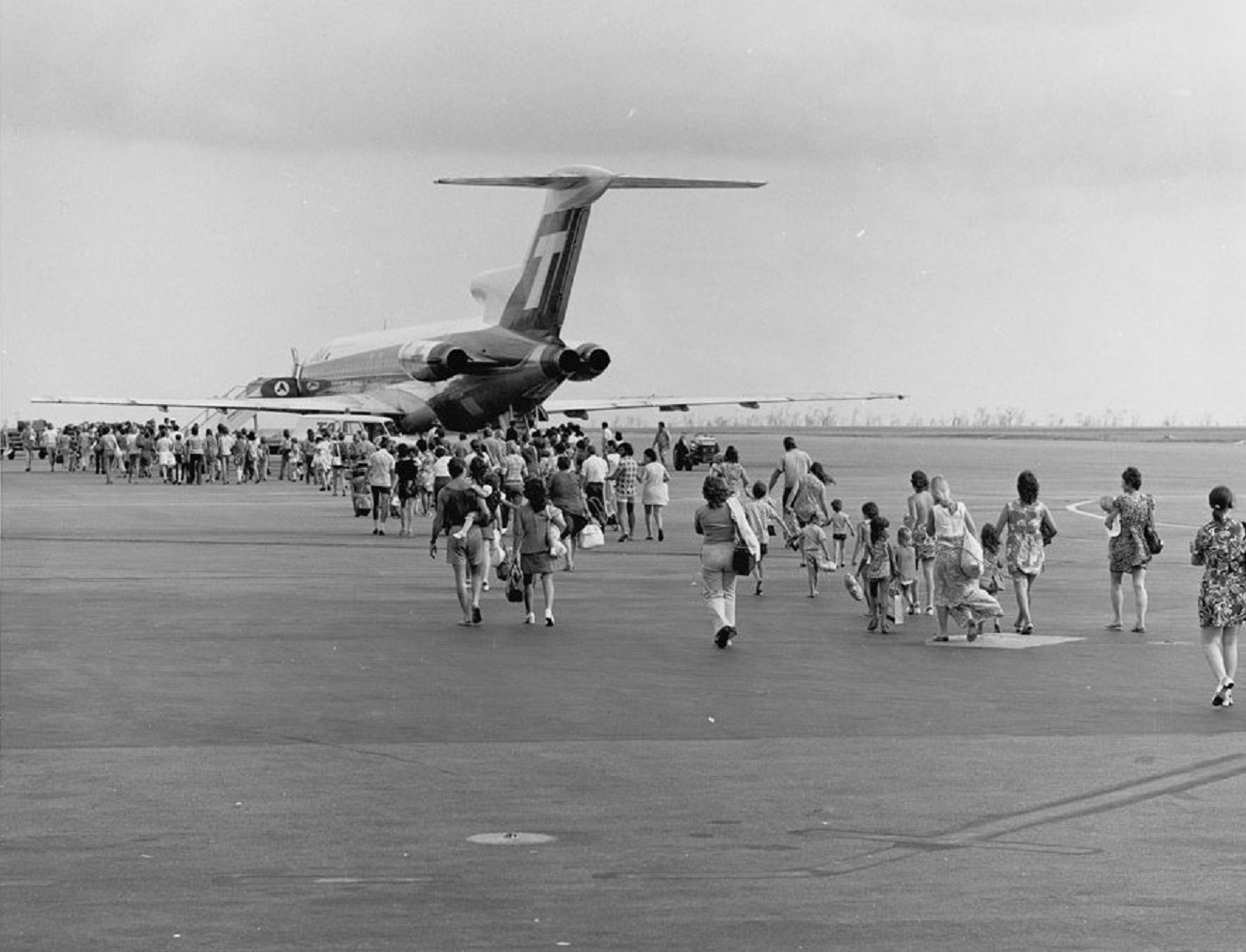A line of evacuees boarding a TAA plane at Darwin airport