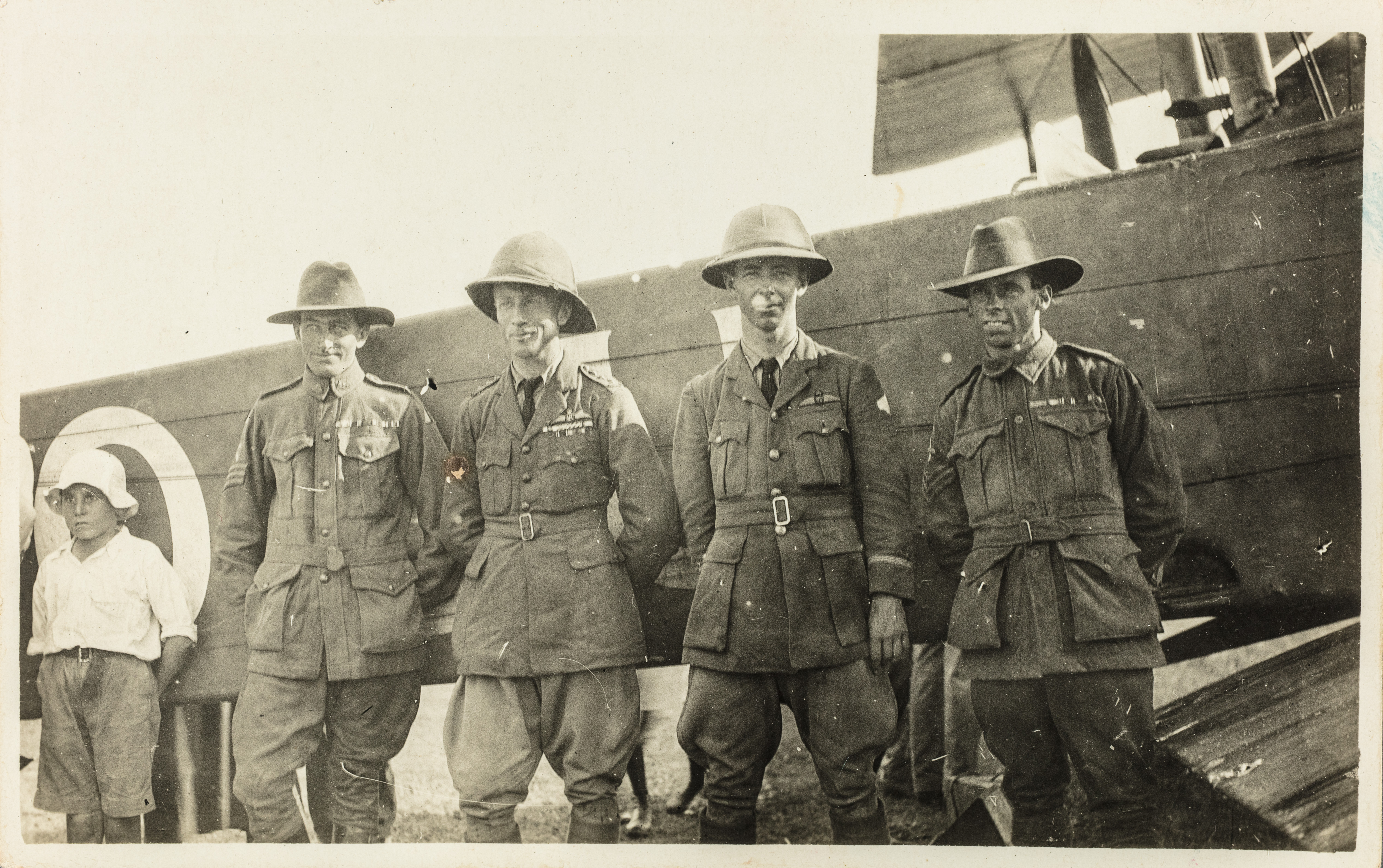 James Bennett, Ross Smith, Keith Smith and Wally Shiers standing in front of their Vickers Vimy in 1919.