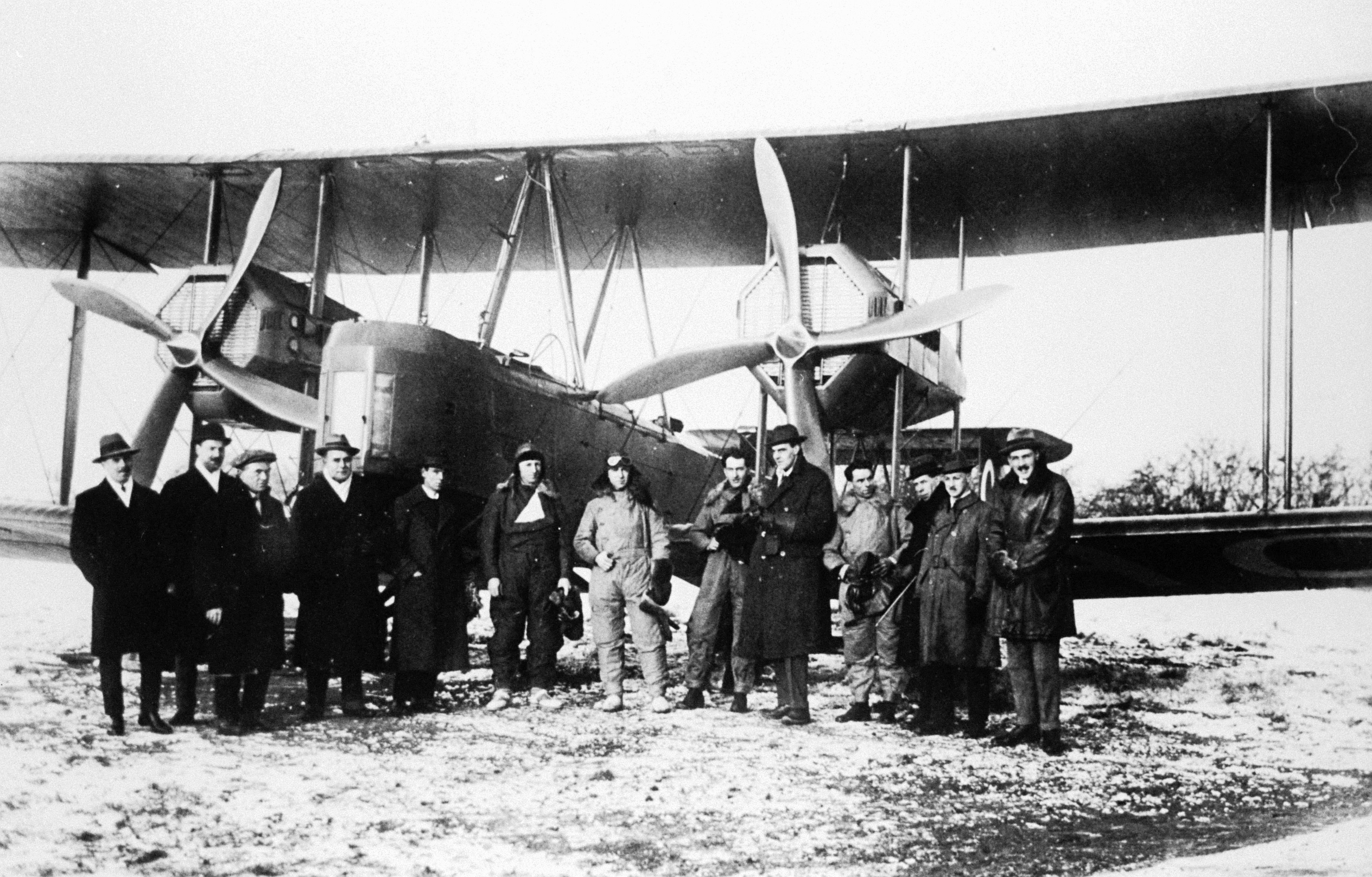 The Smith Brothers, Bennett and Shiers stand beside their Vickers Vimy aircraft before take-off at Hounslow Heath in 1919.