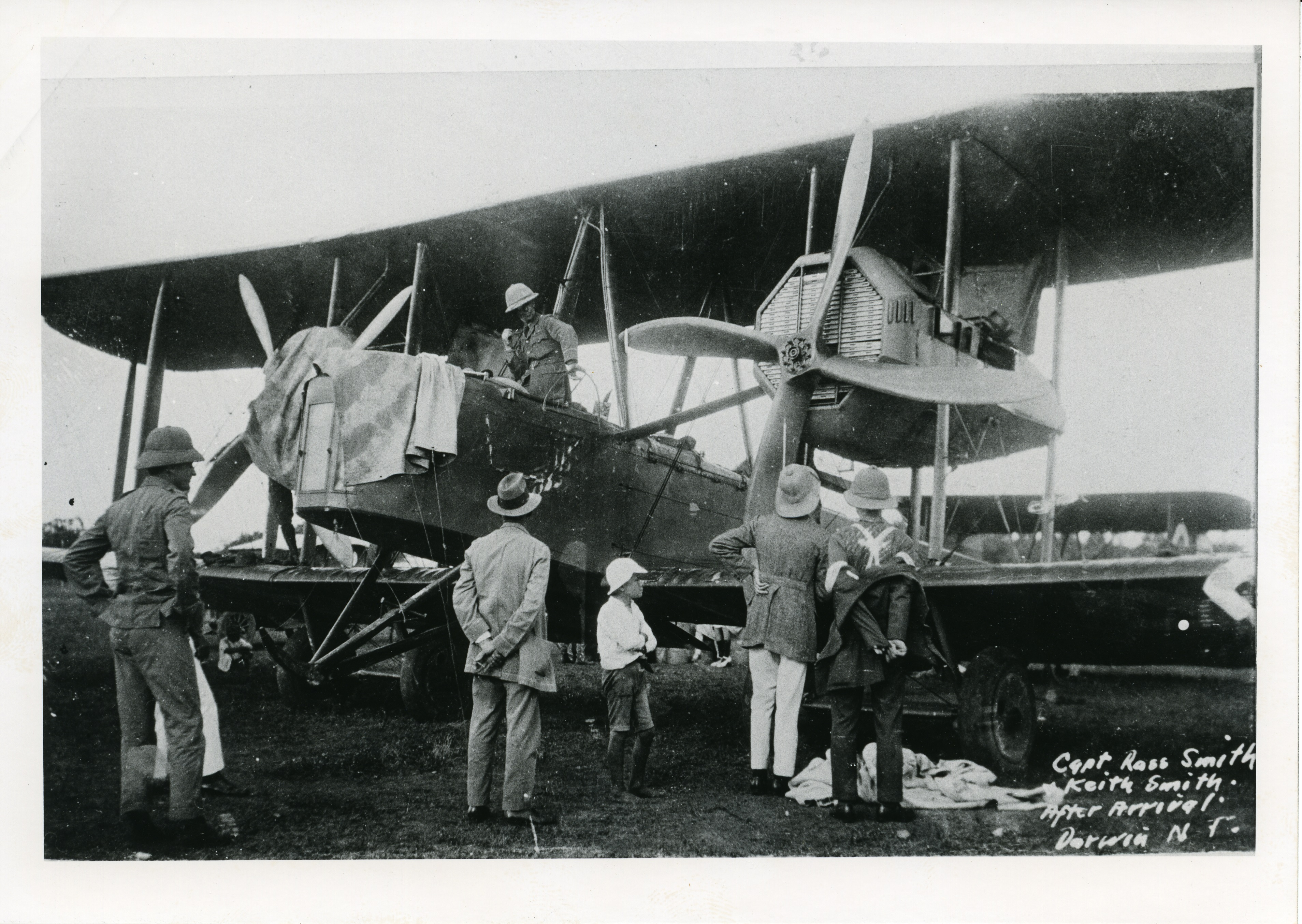 Inspecting the Smith Brothers aeroplane after landing in Darwin on 10 December 1919.