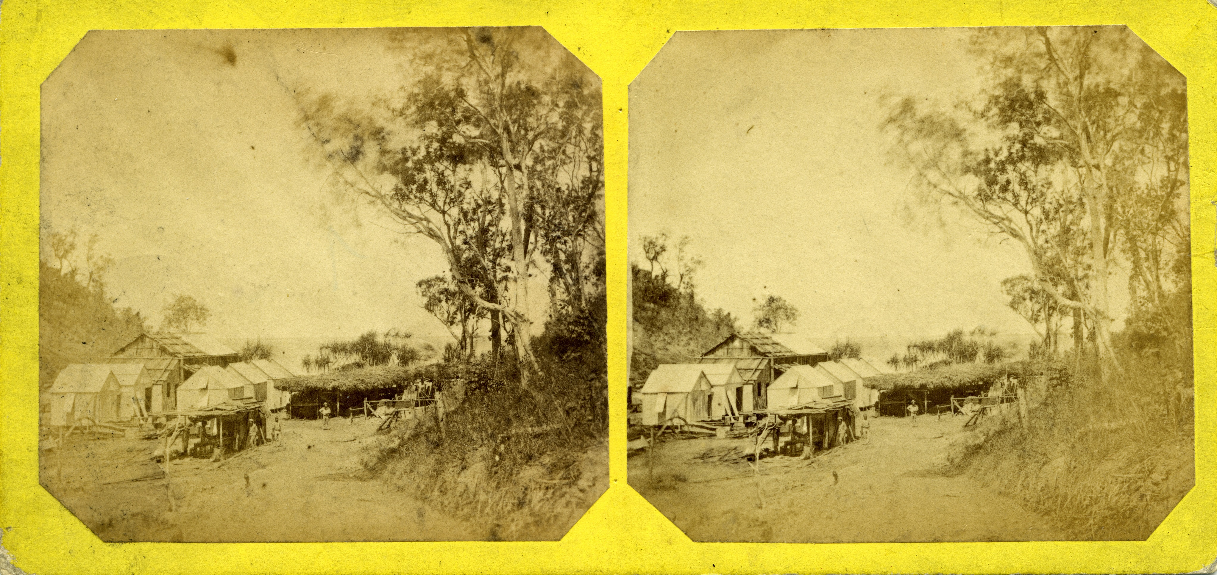 Stereoscopic image of Main Camp and stables roofed with bark, 1869