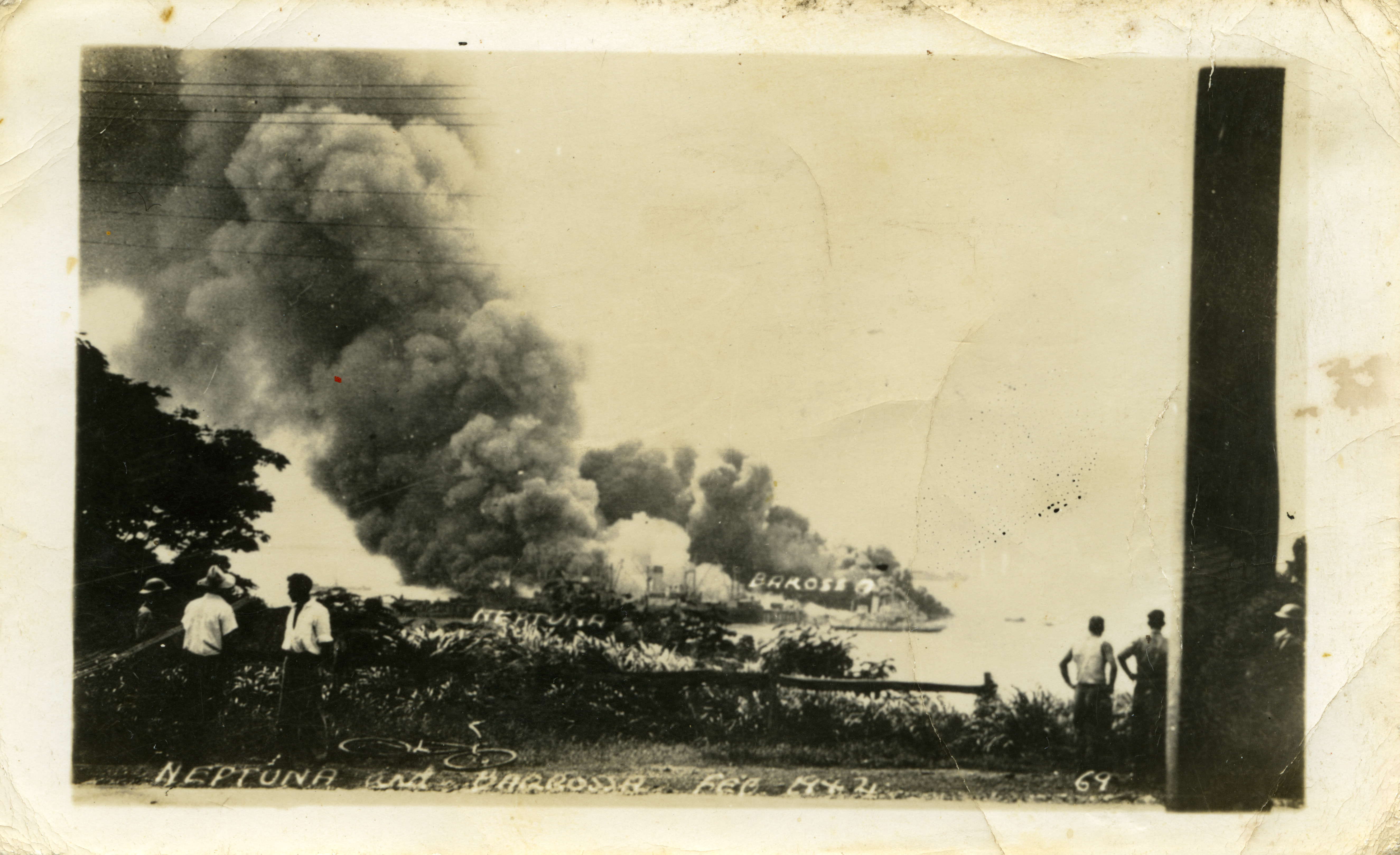 Onlookers observe burning ships in Darwin Harbour after the first Japanese bombing raid in February 1942.