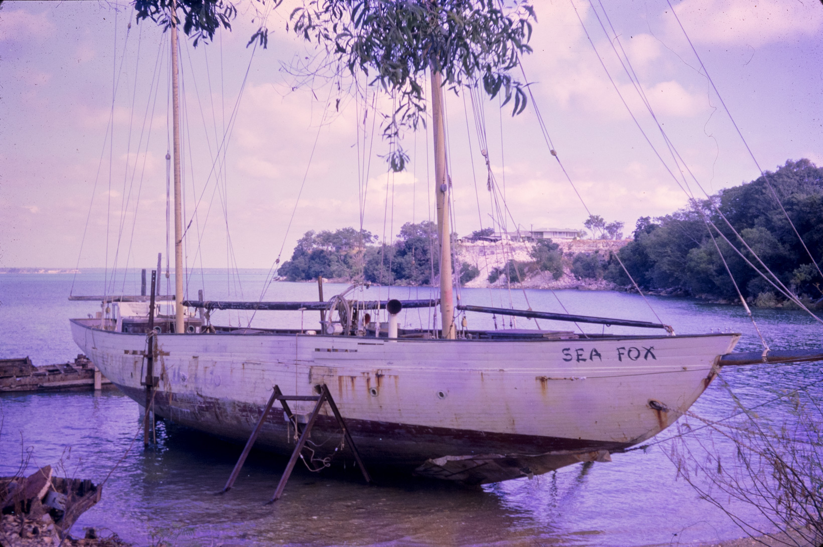 A two-masted yacht in a state of disrepair is beached at Doctors Gully near Darwin.