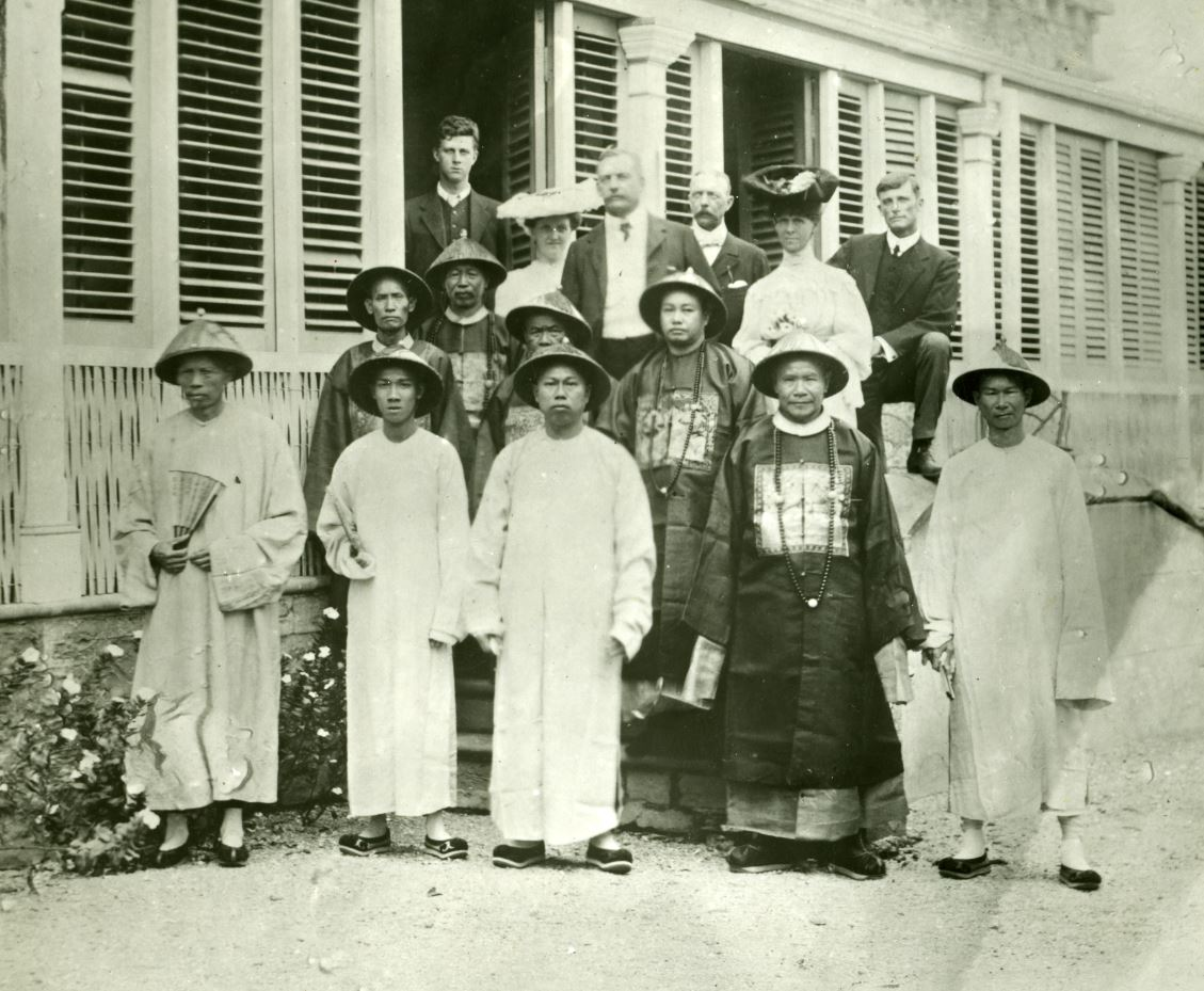 Several people standing in front of a house